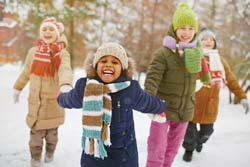 A group of children playing in the snow